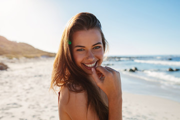 Beautiful young woman smiling on the beach