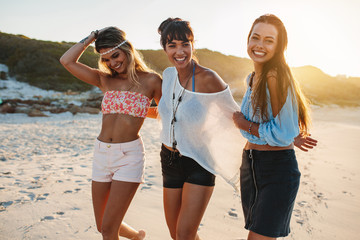 Group of female friends on the beach together