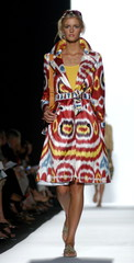 A model wears an ikat coat over a yellow cashmere sweater at Fashion Week in New York on September 1..