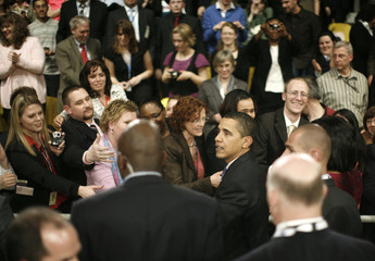 US President Obama meets members of the audience during a town hall meeting in Strasbourg