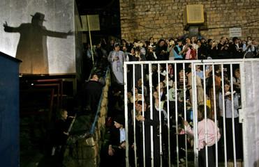 Shadow of ultra-Orthodox Jewish man dancing is seen as ultra-Orthodox Jewish women watch during Lag ...