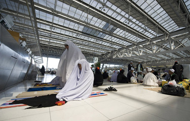 Muslim women from southern Thailand stranded in Bangkok's Suvarnabhumi Airport pray inside the departures hall