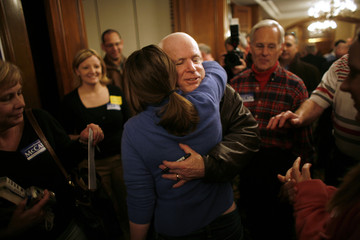 Presidential hopeful and US Senator McCain greets a supporter after a town hall meeting in Des Moines