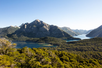 Panorama of the Mountain range with lake. Hiking adventure in San Carlos de Barilochein close to Río Negro, Argentina. Beautiful landscapes around the shores of Nahuel Huapi Lake and National Park wit
