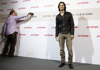 "Director Elliot takes a photo of actor Barnes during the photo call for their movie ""Easy Virtue"" at the Rome Film Festival"