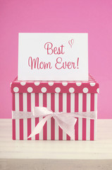 Happy Mothers Day pink and white gift with greeting card.
