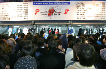 Japanese fans queue to buy souvenirs at Rolling Stones opening concert in Tokyo