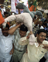 BJP ACTIVISTS CARRY AN EFFIGY OF ONE OF THE CONVICTED PERSONS OVERATTACK ON INDIAN PARLIAMENT DURING ...