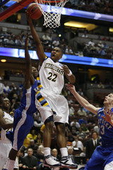 Marquette's Jerel McNeal goes up to score against Kentucky during the second half of their first round NCAA men's basketball tournament game in Anaheim