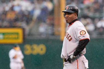 Giants Bonds stands on third base in game against the Athletics in Oakland