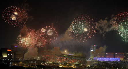 Fireworks explode over the National Stadium, also known as the Bird's Nest, during the closing ceremony of the Beijing 2008 Olympic Games