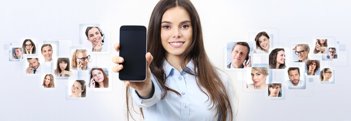 cheerful smiling woman showing blank smart phone screen, with person in background. social network concept