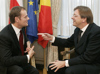 Poland's Prime Minister Donald Tusk and his outgoing Belgian counterpart Guy Verhofstadt attend a meeting in Brussels