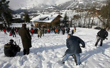 """Members of the media stand in front of the chalet """"Milky Way"""" in the Swiss mountain resort of Gstaad"""