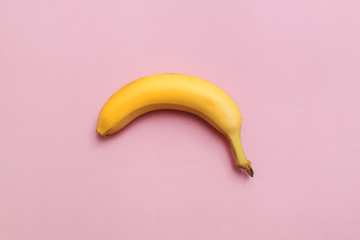 ripe banana on a pink background