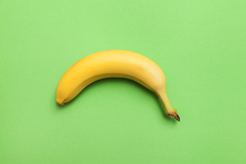 ripe banana on a green background