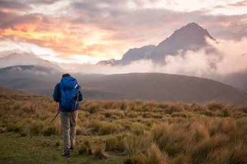 Man hiking by mountains, Ecuador, South America