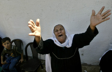 A Palestinian woman relative of Mohammed Ali mourns during his funeral in Jabalya refugee camp.