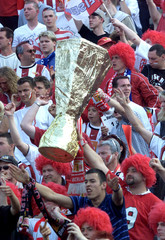 UNION BERLIN SUPPORTERS CELEBRATE WITH A MOCK TROPHY PRIOR TO GERMAN SOCCER CUP FINAL IN BERLIN.