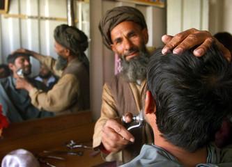 AFGHAN MAN HAS HIS BEARD SHAVED IN KABUL.