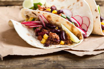 Chili con carne tacos on craft paper