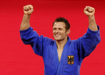 Ole Bischof of Germany waves after winning the men's -81kg judo final at the Beijing 2008 Olympic Games