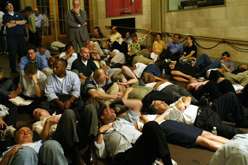 PEOPLE LAY ASLEEP AT GRAND CENTRAL AFTER POWER OUTAGE.