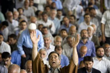 An Iranian worshipper prays during Friday prayers in Tehran