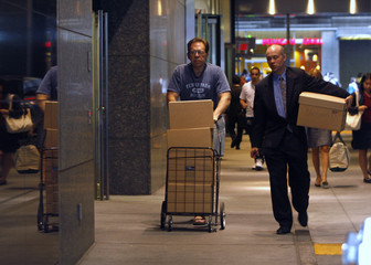 File photo of two men walking out of the Lehman Brothers building with boxes in New York