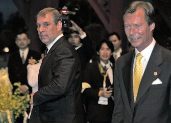 Britain's Prince Andrew walks with Luxembourg Grand Duke Henri as they arrive at the Thai Navy headquarters in Bangkok