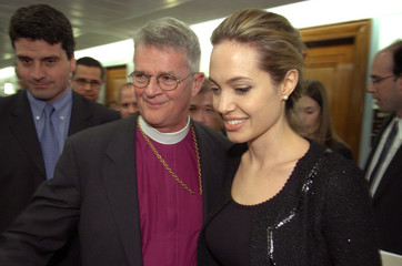Actress Jolie and Episcopal Bishop Griswold arrive at a news conference in Washington