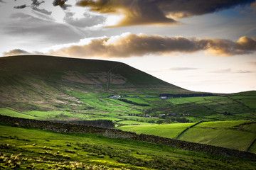 Scenic View On Pendle Hill At Springtime, afternoon sunlight casting shadows on the hills, Lancashire, England UK