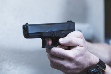 Gun Aimed with Finger on Trigger