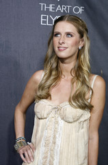 Model Nicky Hilton poses at the opening of the Dolce & Gabbana flagship boutique in Los Angeles