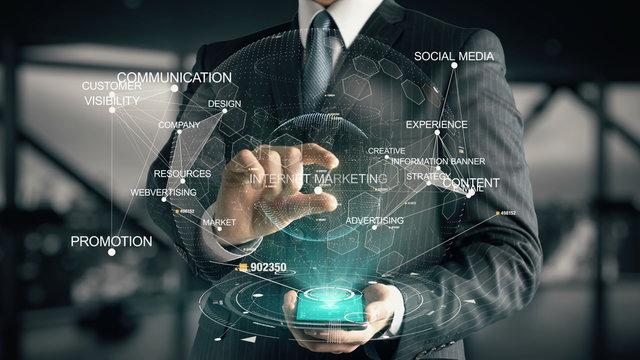 Businessman with Internet Marketing hologram concept