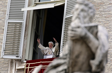 Pope Benedict XVI waves as he arrives to lead Angelus prayer from window of his private apartments in Saint Peter's Square