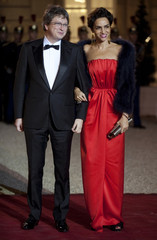 French businessman Seydoux and his wife Farida arrive at a state dinner at the Elysee Palace