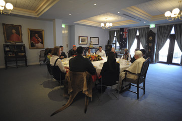 Pope Benedict XVI sits with young people during a lunch at St. Mary Cathedral house in Sydney