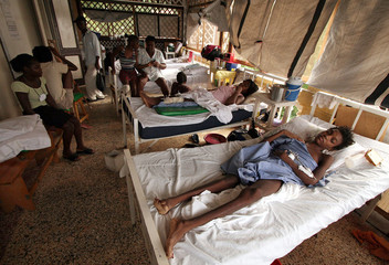 Patients lie in beds after receiving medical help in rehabilitation centre at MSF main base in the neighbourhood of Pacot in Port-au-Prince