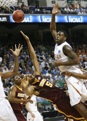 Damion Balbay of the University of Texas loses the ball as he goes to the basket during the first half of their first round NCAA tournament basketball game in Greensboro