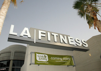 "A banner for the ""Fresh & Easy Neighborhood Market"" is seen below an LA Fitness logo in Hollywood"