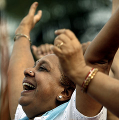 A member of a laughter club participates in a laughing competition in Mumbai