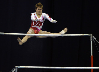 Switzerland's Stamfli competes on the uneven bars during a qualification competition at the World Cup in Artistic Gymnastics in Moscow