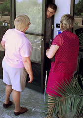 SECURITY GUARD AT ALCOR IN SCOTTDALE ARIZONA TALKS WITH VISITORS.