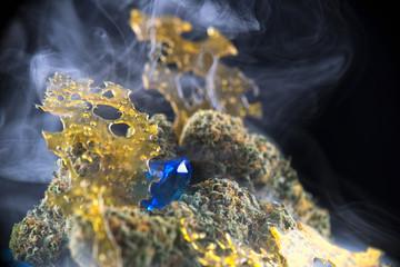 Macro detail of cannabis nugs and marijuana concentrates (aka shatter)