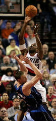 Trail Blazers Shareef Abdur-Rahim runs over Mavericks Van Horn.