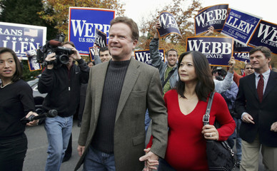 Democratic Senate candidate for Virginia Webb and his wife arrive to vote in Falls Church