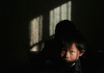 A child of migrant workers is seen inside a classroom at a primary school in Jinzhai county