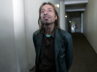 """French climber Alain Robert, known as """"Spiderman"""", leaves the lock-up at the courthouse in Kuala Lumpur"""