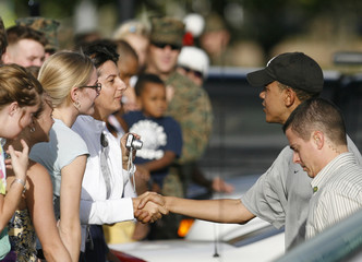 US President-elect Obama greets people after working out at the Semper Fit gym at Marine Corps Base Hawaii while on vacation over the Christmas holidays in Honolulu